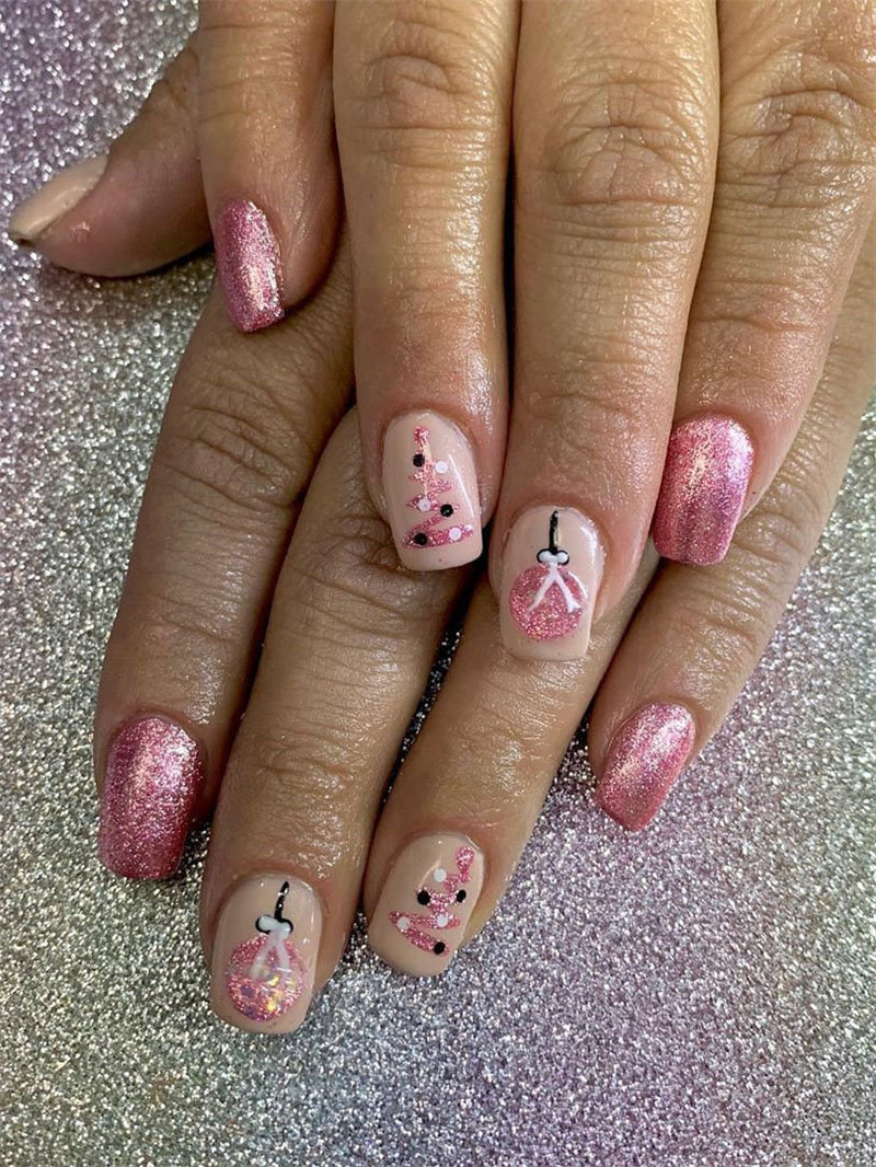 Here we have Christmas nails designs. All of the nails have a different design including snowflakes, reindeer and so on. #WinterNails #ChristmasNails